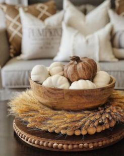 a-stand-with-wheat-wooden-beads-a-wooden-bowl-with-pumpkins-is-a-lovely-rustic-centerpiece