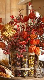 a-vase-covered-with-corn-cobs-dried-blooms-berries-and-soem-twine-is-a-bold-centerpiece-for-fall-or-Thanksgiving