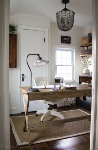 a-welcoming-farmhouse-home-office-with-a-wooden-desk-a-jute-rug-open-shelves-a-metal-chandelier-and-a-crystal-lamp