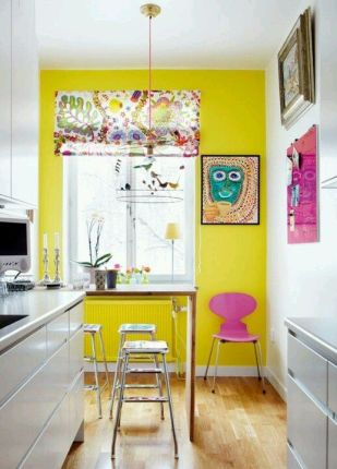 a-whimsical-kitchen-with-a-shiny-yellow-wall-bold-artworks-a-console-table-and-stools-a-floral-shade-on-the-window