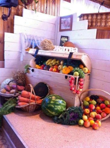 a-wooden-chest-with-lots-of-veggies-and-fruits-and-baskets-with-them-around-is-a-pretty-rustic-decoration-to-rock