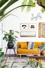 an-airy-boho-living-room-with-a-mustard-sofa-printed-textiles-and-a-gallery-wall-potted-blooms-and-greenery-and-calligraphy