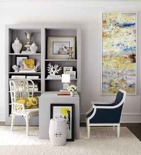 an-elegant-home-office-with-dove-grey-walls-a-built-in-storage-unit-with-a-built-in-desk-a-couple-of-chairs-and-a-statement-artwork