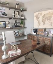 an-industrial-farmhouse-home-office-with-open-industrial-shelves-a-wooden-desk-a-shutter-door-storage-unit-vintage-decor-and-monograms