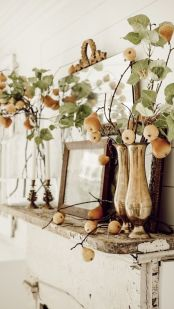 beautiful-greenery-arrangements-with-pears-and-apples-and-candles-will-make-your-mantel-ultimately-beautiful-and-cozy