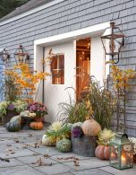 colorful-and-all-natural-heirloom-pumpkins-in-buckets-and-on-the-ground-for-cozy-fall-and-Thanksgiving-decor