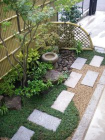 grass-concrete-tiles-shrubs-a-thin-tree-a-stoen-bowl-fountain-and-rocks-for-a-lovely-and-chic-Japanese-inspired-look