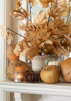 natural-pumpkins-and-gourds-candles-and-fall-leaves-are-amazing-for-fall-and-Thanksgiving-decor