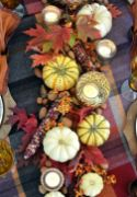 rustic-Thanksgiving-decor-of-pumpkins-bold-leaves-berries-and-corn-cobs-is-lovely-for-fall-too