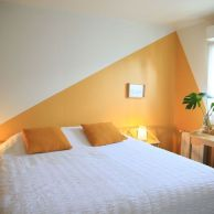 two-color-block-accent-walls-in-yellow-and-white-here-solve-the-problem-of-a-low-ceiling-making-it-look-a-bit-taller-than-it-is
