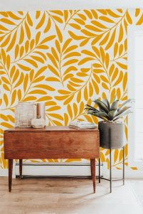 yellow-botanical-print-wallpaper-a-mid-century-modern-console-a-potted-plant-to-spruce-up-a-small-awkward-nook