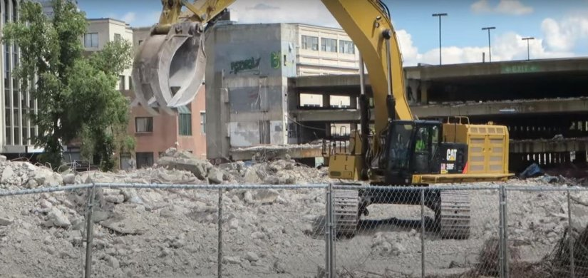 Demolition of building generating construction waste (Source : youtube.com/diecastmania)