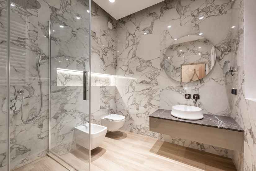 bathroom interior with bidet and toilet near sink and shower