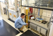 Researcher adjusting carbon fuel cell experiment