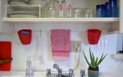 Small kitchen ideas: tension rod above sink