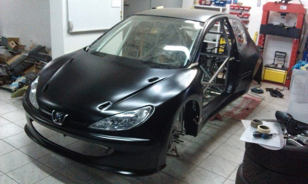 Peugeot 206 with Two Suzuki Motorcycle Inline-Four