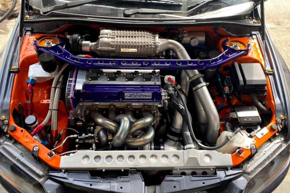 Mitsubishi Evo 8 with a twin-charged billet 4G63 inline-four