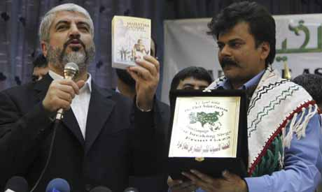 Feroze Mithiborwala delivers a gift to Hamas leader Khaled Meshaal during a meeting in Damascus