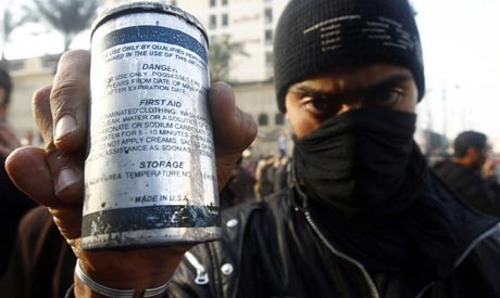 Protester in January 2011 in Egypt displays US-made tear gas canisters (Photo: Reuters)