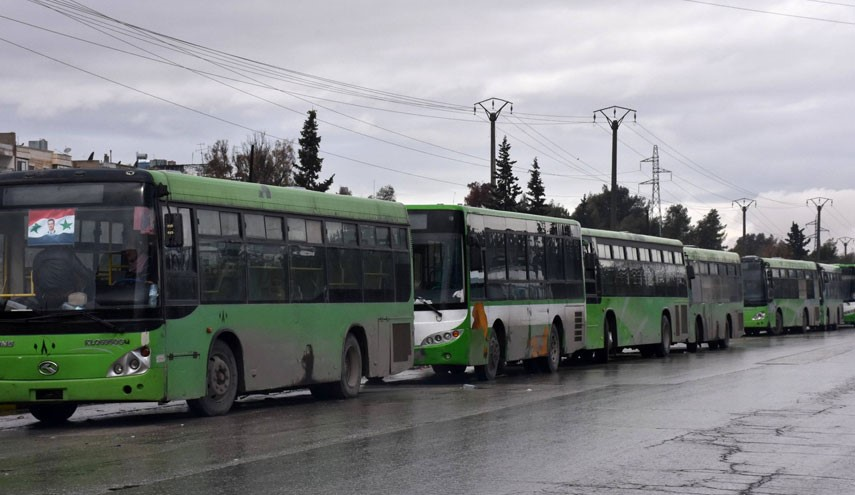 Government green buses in Aleppo for evacuation operations