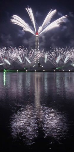 Fireworks explode over the Juche Tower on the banks of the Taedong River in Pyongyang to celebrate North Koreas nation founder Kim Il-sungs centenary in Pyongyang on Sunday. /Reuters-Yonhap