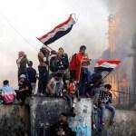 Iraq parliament approves PM resignation, protesters mourn dead