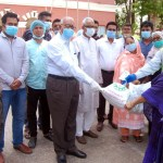Khulna mayor distributes cheque, relief materials