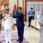 New Navy Chief adorned with admiral rank badge