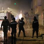 Tunisians clash with police days after revolution anniversary