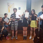 German School of Music violin professor Viktoria Kaunzner poses with students and presents a donation of music from German composer Daniel Seel to be added to the GSM library. (Photo: Chun Min Ji)