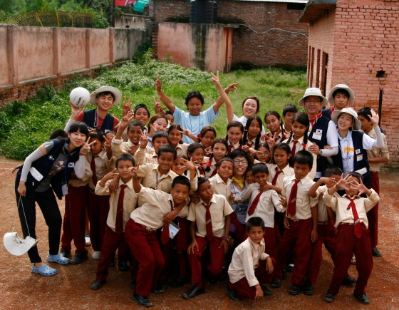 Student members of the Korean Universities Council for Social Service help Namuna Machindra School.