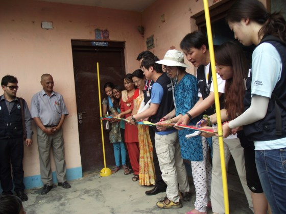 Ribbon-cutting ceremony at hostel after toilets are repaired