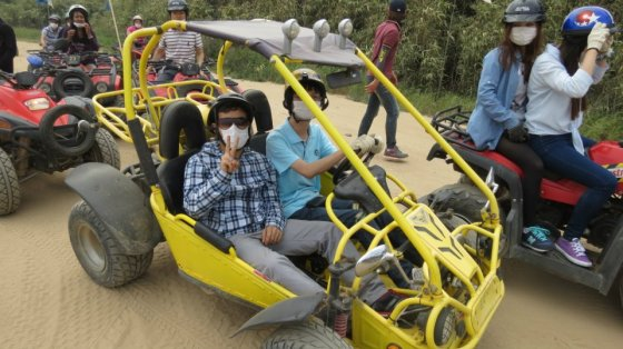 KISS members ride ATVs. Reporter Bikash KC flashes a peace sign. (PHOTO: Park Jin-seok)