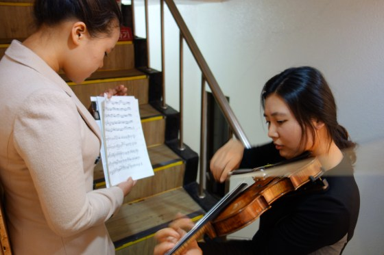 With a little help from Park Haram, student Jeon So-young draws the program to a close with a Partita for solo violin by Bach. (Photo: Charles Ian Chun)