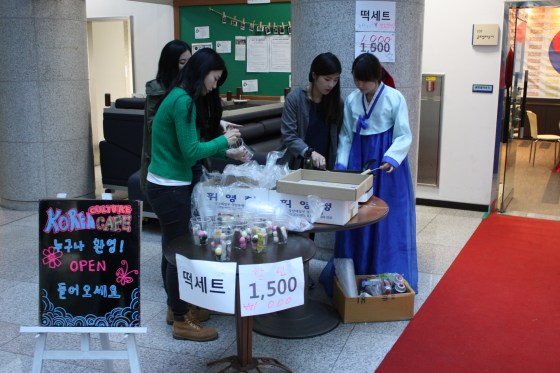 KISS members set up shop to sell rice cakes.