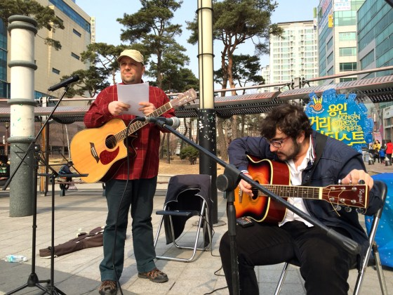 Eldin Husic and Onur Sahil of The Light get ready to play their set at the Yongin Street Artists event at Dongbaek Lake Park. (Photo: Charles Ian Chun)