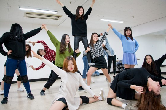 Members of student cheerleading club Mei Hua strike a finishing pose during a practice session. (Photo: Charles Ian Chun)