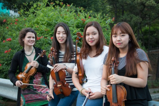 Kangnam University German School of Music violin professor Viktoria Kaunzner and her students (from left) Juhee Ihm (3rd-year), Haram Park (4th-year), and Jiwon Lim (2nd-year), who performed in Germany with the Academic Orchestra Berlin over the summer. Photo: Charles Ian Chun