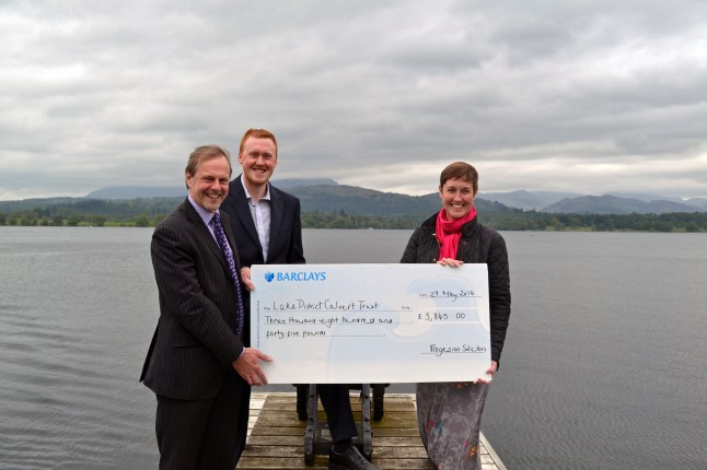 English Lakes and Progression Solicitors presenting £3,845 raised from the event to the Calvert Trust