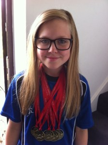 Taylor with her swimming medals