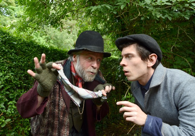 Fagin(Russell Richardson) gives pickpocketing tips to Oliver(Jerome Thompson)