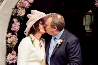 Simon and Diana recreate 'the kiss' outside the Church in the village of Grasmere