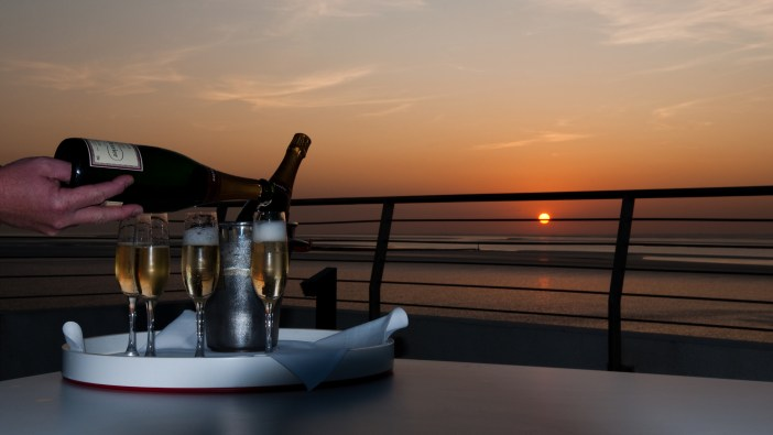 Watching the sun setting with a glass of bubbly