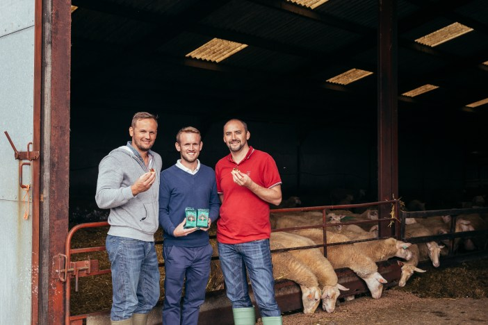 David Orchard shows Gary and Damian around the farm