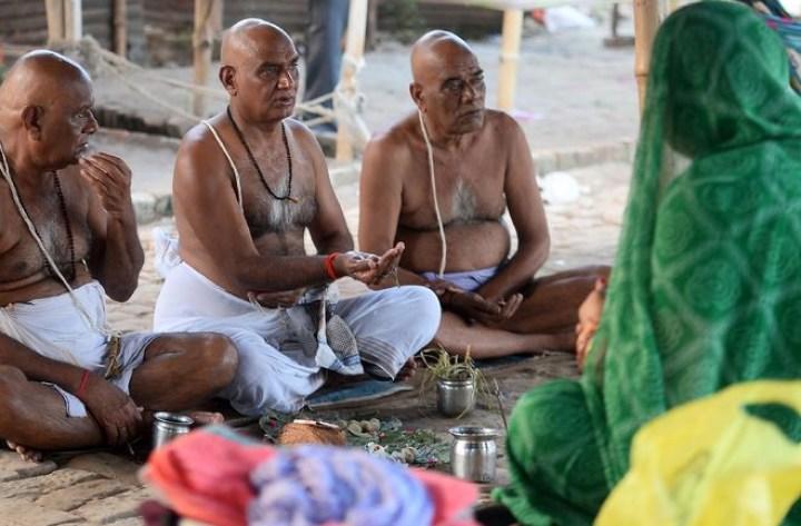 Men offering Pitri Puja 16 Shradh Festivals of Importance