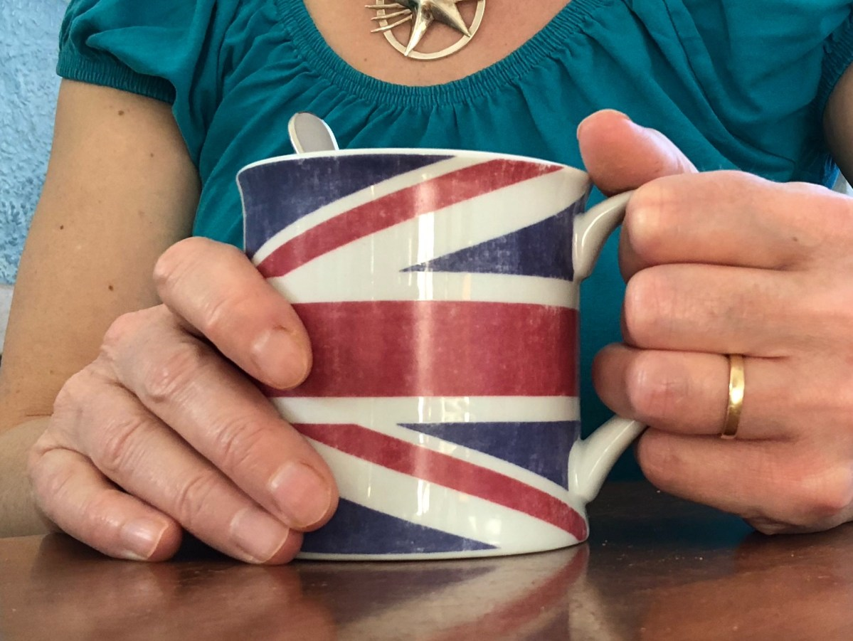 Coffee mug with the Union Jack on it being held by a woman