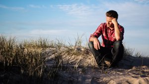 Man struggling with self-doubt