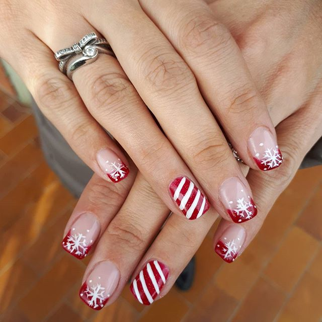 Red manicure tips and snowflakes christmas nails