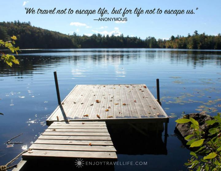 Dock in a Woodstock NH pond with travel quote overlay