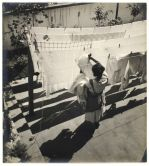 jan-lauschmann-woman-hanging-laundry-on-clothesline-1930s